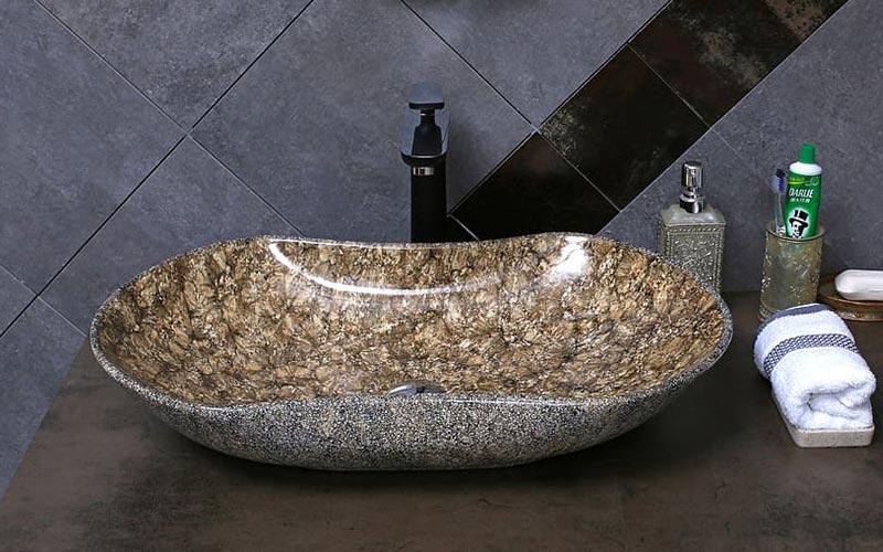 Delo blogpost - i miscelatori a corpo alto - lavabo a bacinella marmo